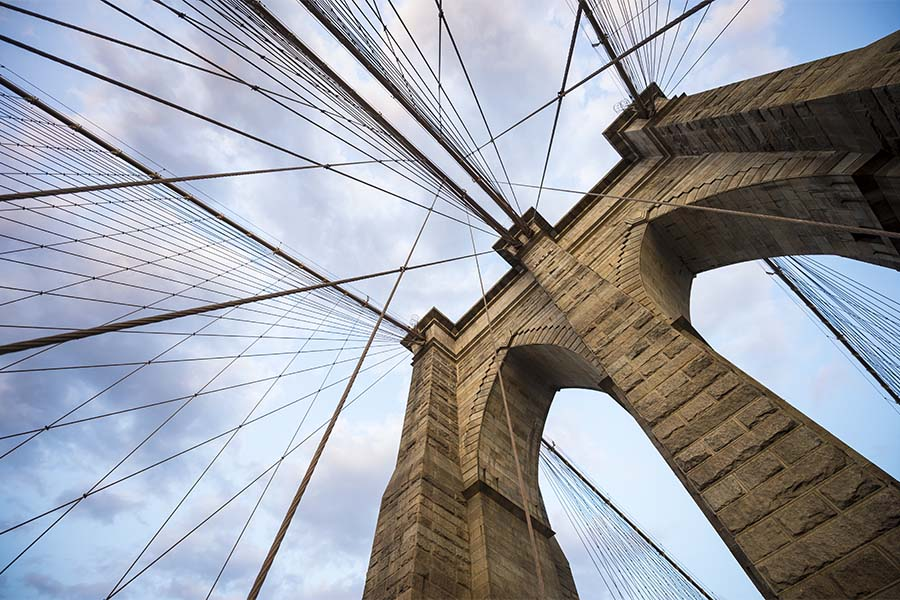 About Our Brokerage - Closeup View of the Brooklyn Bridge in New York City