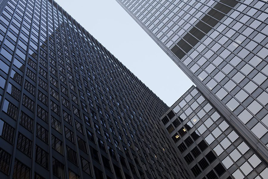Business Insurance - Abstract View of Tall Buildings in Chicago Looking Up
