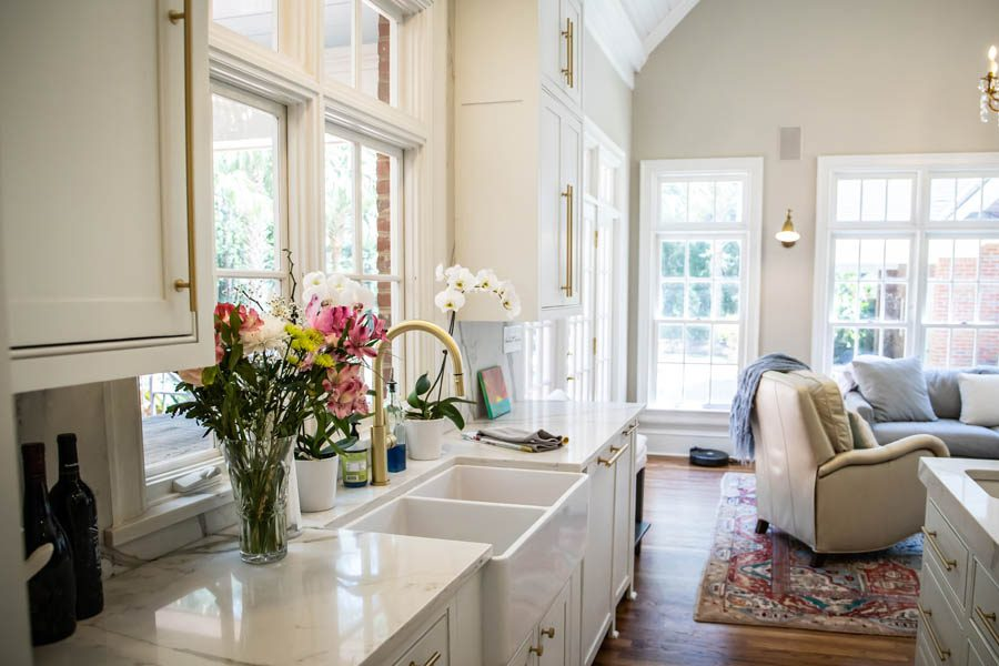 Personal Insurance - Modern Farmhouse Kitchen with a Gold Faucet and Flowers by the Farmhouse Sink