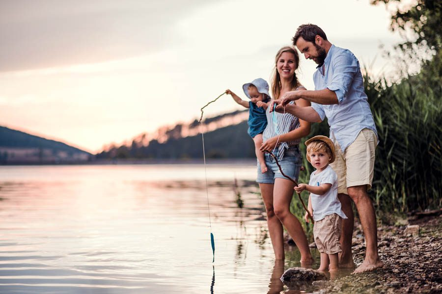 Client Center - Small Family Fishing at the Lake at Sunset