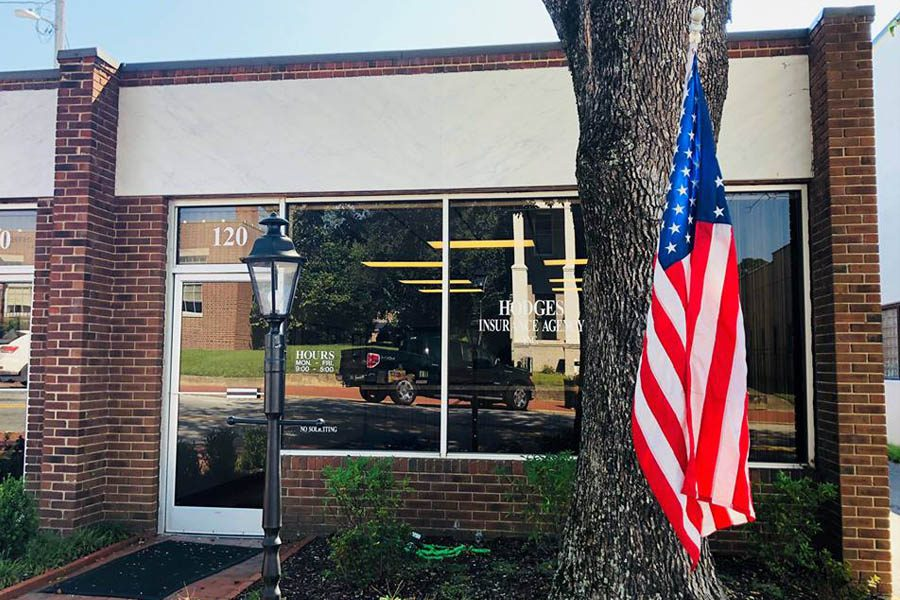 Contact Us - Louisburg, NC Insurance Building with an American Flag Out Front