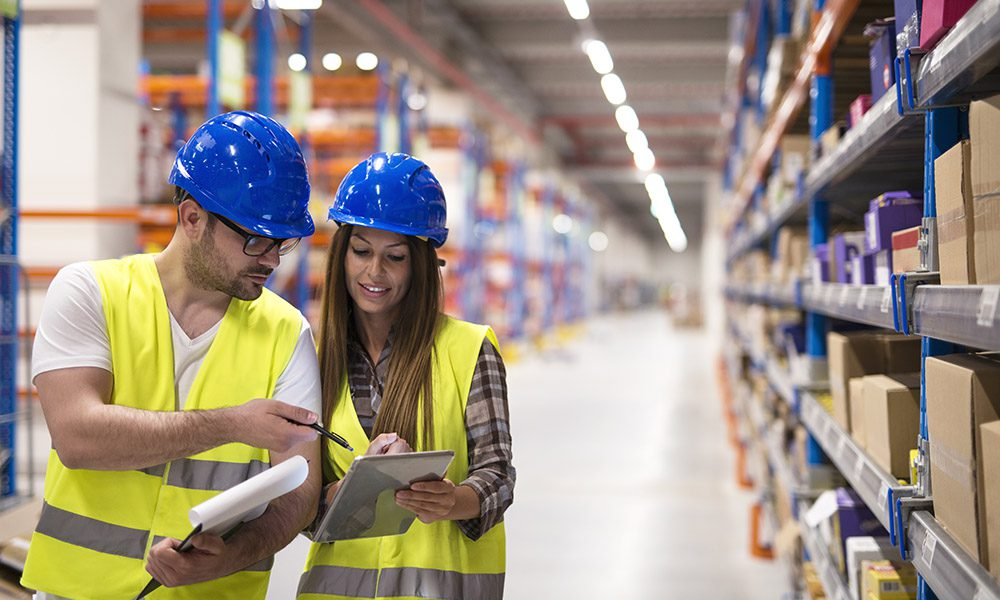 Blog - Preparing for an OSHA Inspection - Warehouse Workers Working Together On a Plan