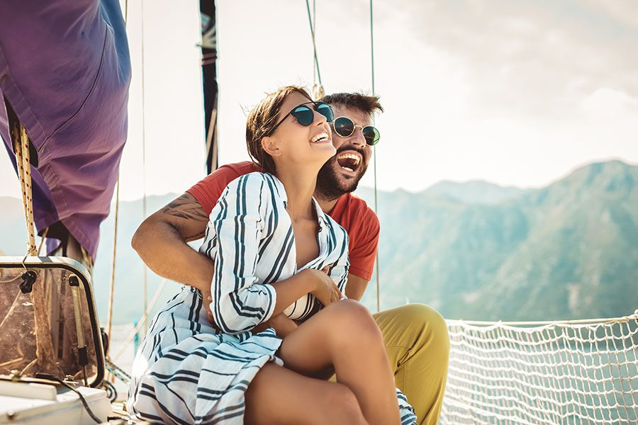 Personal Insurance - Young Couple Having Fun on a Luxury Yacht at Sea