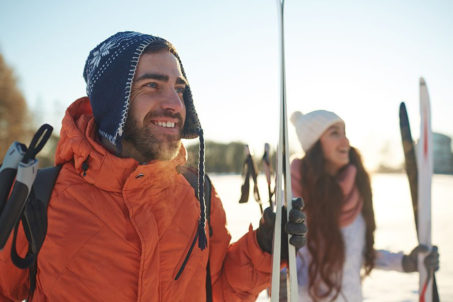 Testimonials - Group of Smiling Skiers Looking Out at the Distance