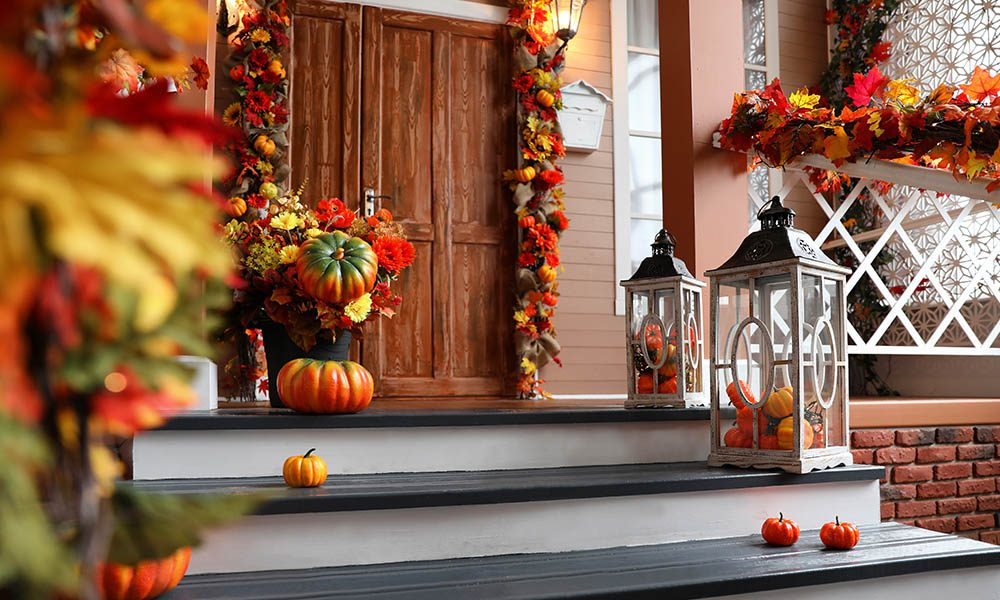 Blog - House Entrance Decorated with Pumpkins and Fall Leaves For Halloween