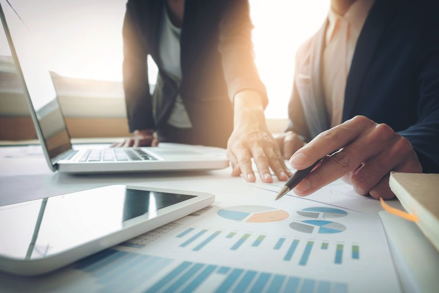 Fiduciary Liability Insurance - Partners Looking Over Numbers for Another Company