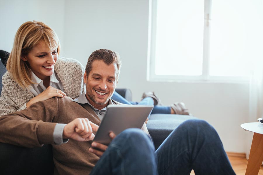 Client Center - Couple Looking at Their Policy on an iPad