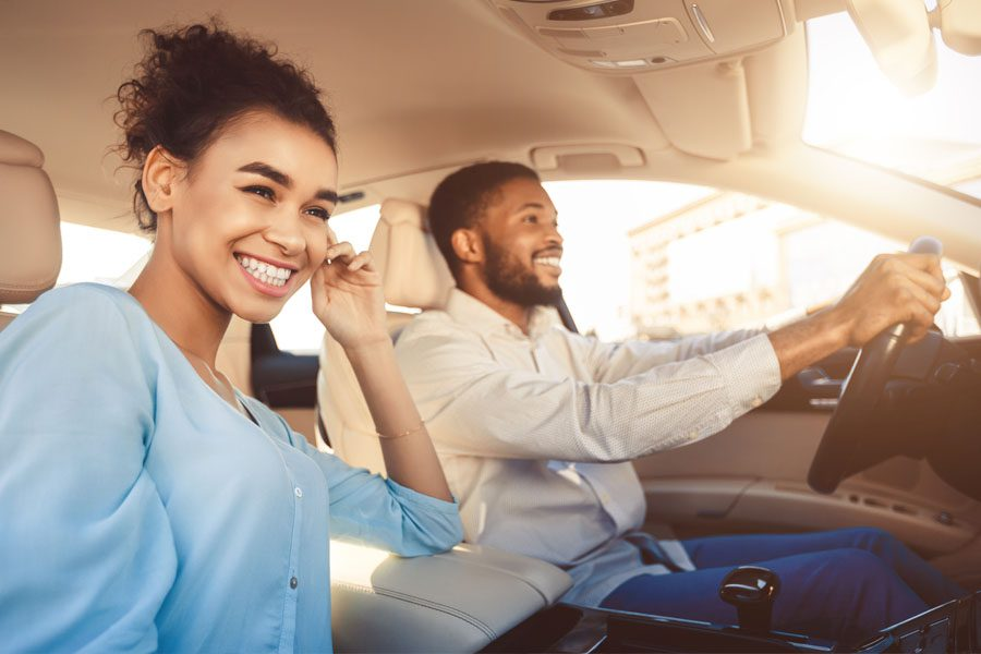 Personal Insurance - Young Couple Riding in a Car in Downtown Lancaster