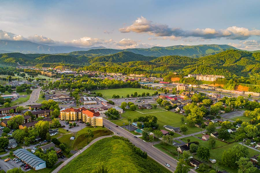 Tennessee - Aerial View Small City In The Summer Between Mountains In Tennessee