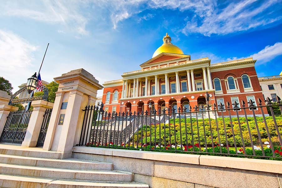 Insurance Quote - State Capital Building Against Blue Sky In Boston Massachusetts