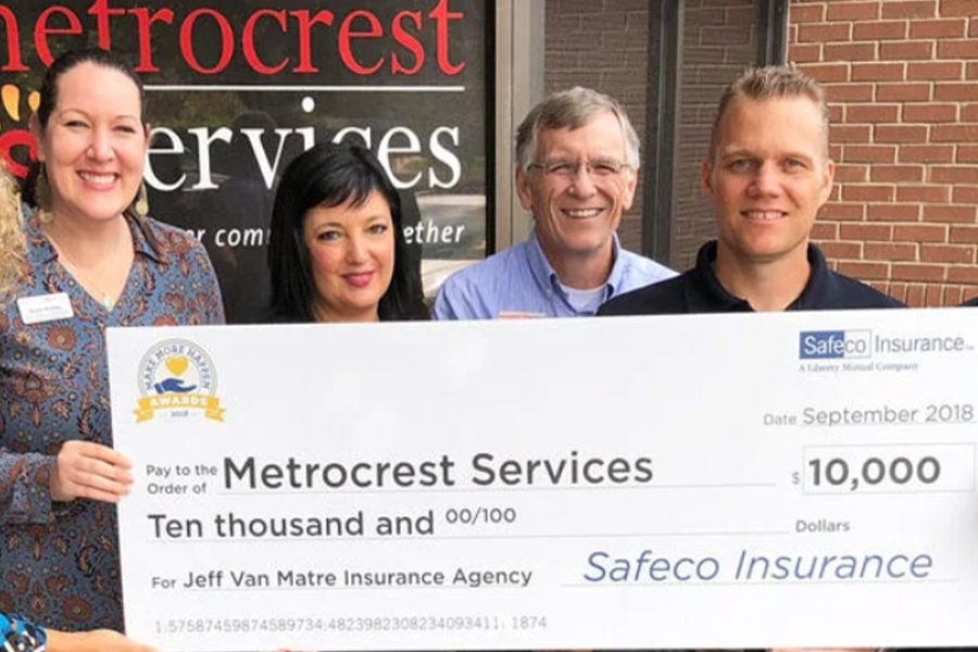 Jeff Van Matre Insurance Agency - Team Giving Back with a Large Check