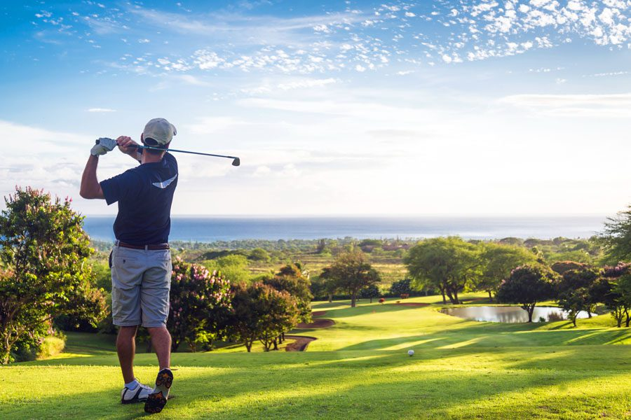 Golf Course Insurance - Man Hitting the Greens in the Sunshine
