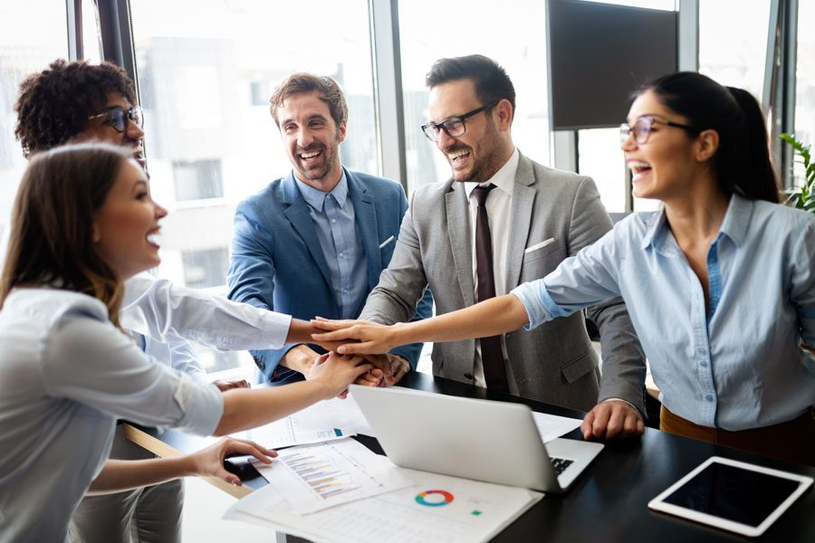 Commercial Umbrella Insurance - Co Workers Cheering Over a Deal