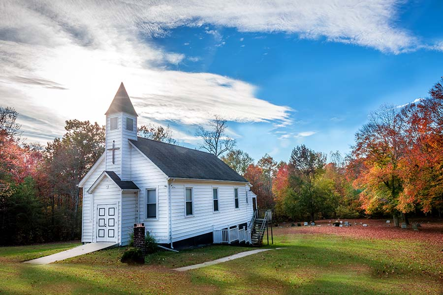 Specialized Business Insurance - Colorful View of a Small Traditional White Church in the Countryside Surrounded by Colorful Fall Foliage