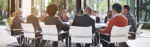 Header-Employees-at-Round-Table