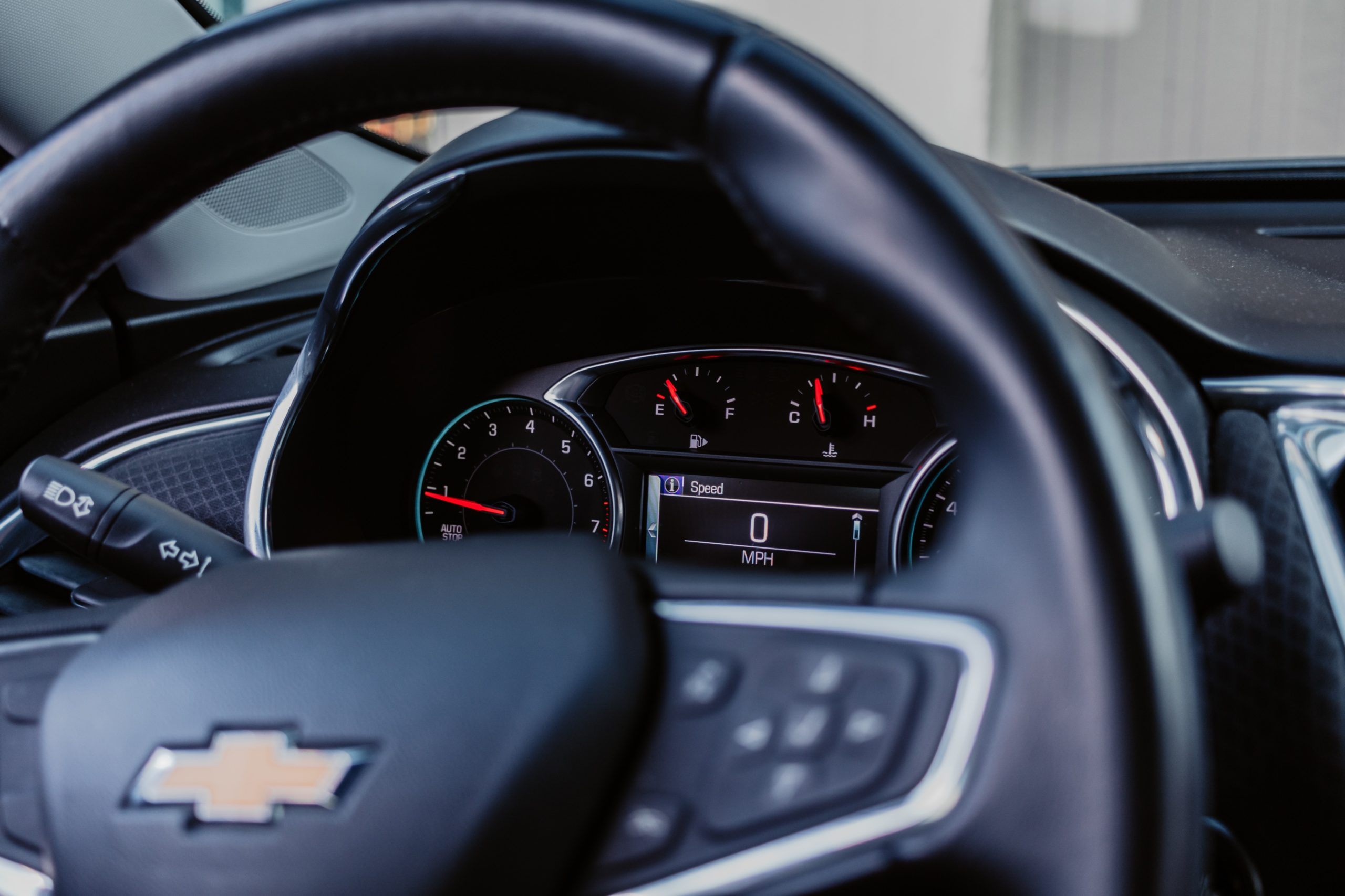 steering wheel of a car looking through to dashboard