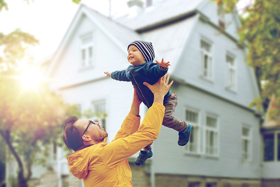 Header - Father Holding Up Son