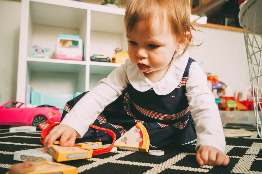 child playing with toys at home daycare