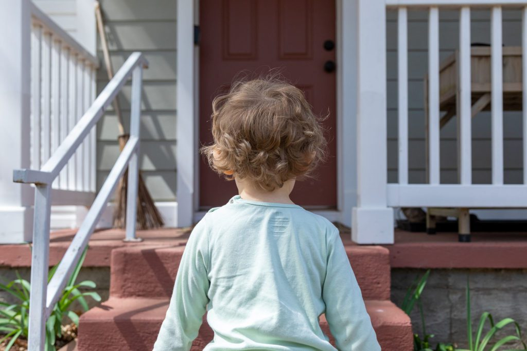 child walking to home daycare door