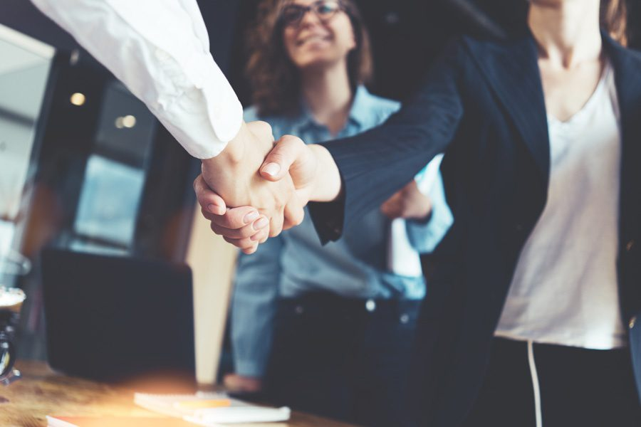 IAB-Partnership-Strong-Handshake-with-Colleagues
