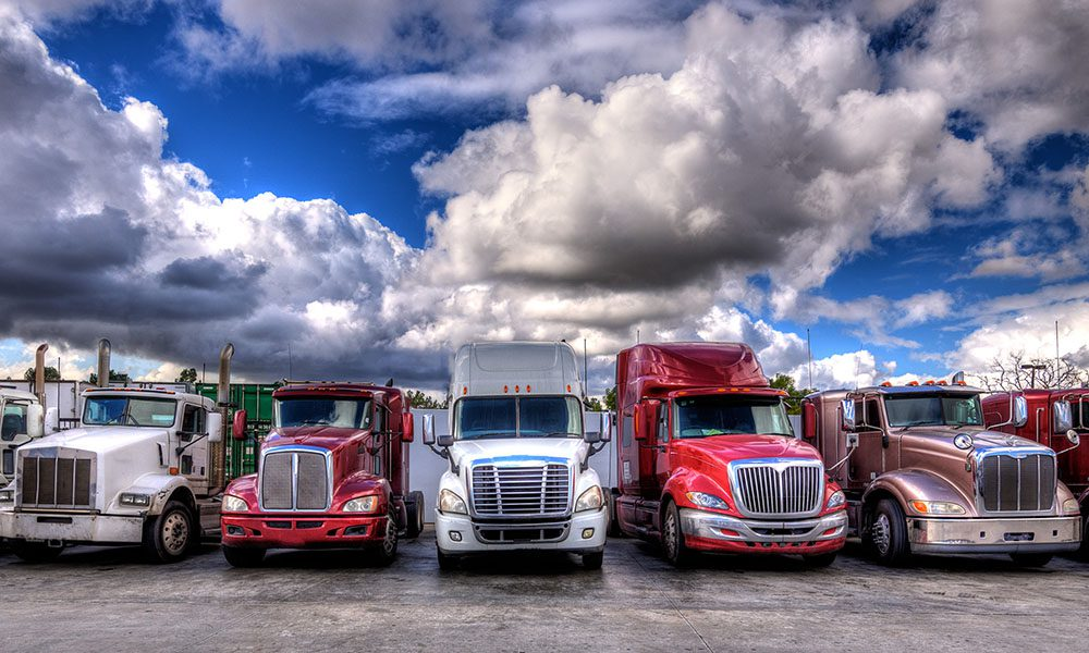 Blog - Trucks Lined Up in a Parking Lot on a Cloudy Day