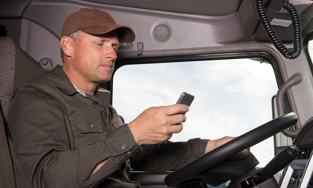 Blog - Commerical Truck Driver Starring at their Phone