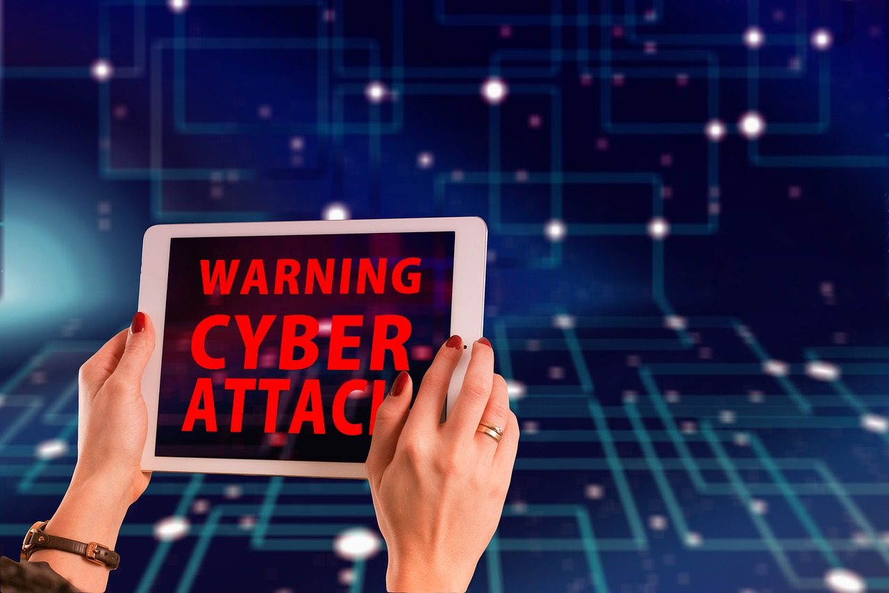 Blog - two hands holding a warning cyber attack sign