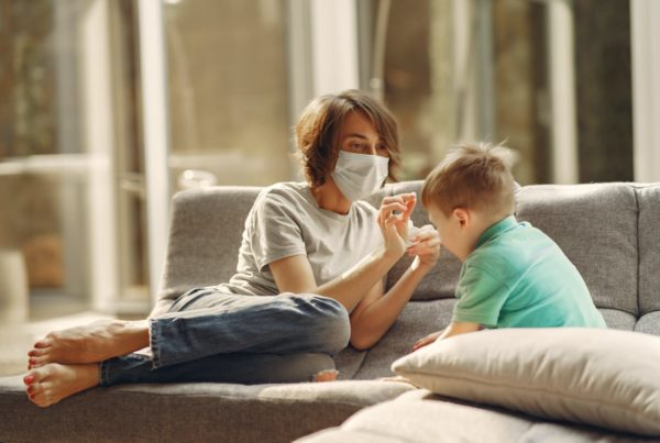 Blog - parent with child in mask_stay at home