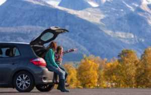 Homepage - Mom and Daughter Near Car and Mountains