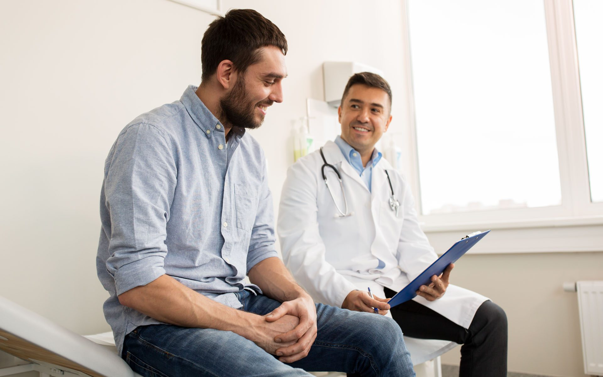 Landing Page - Doctor with Male Patient