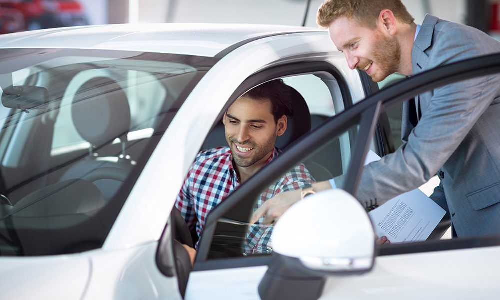 Blog - Do You Understand the Difference Between Agreed Value vs. Stated Value - Man Buying A New Car Off A Salesmen
