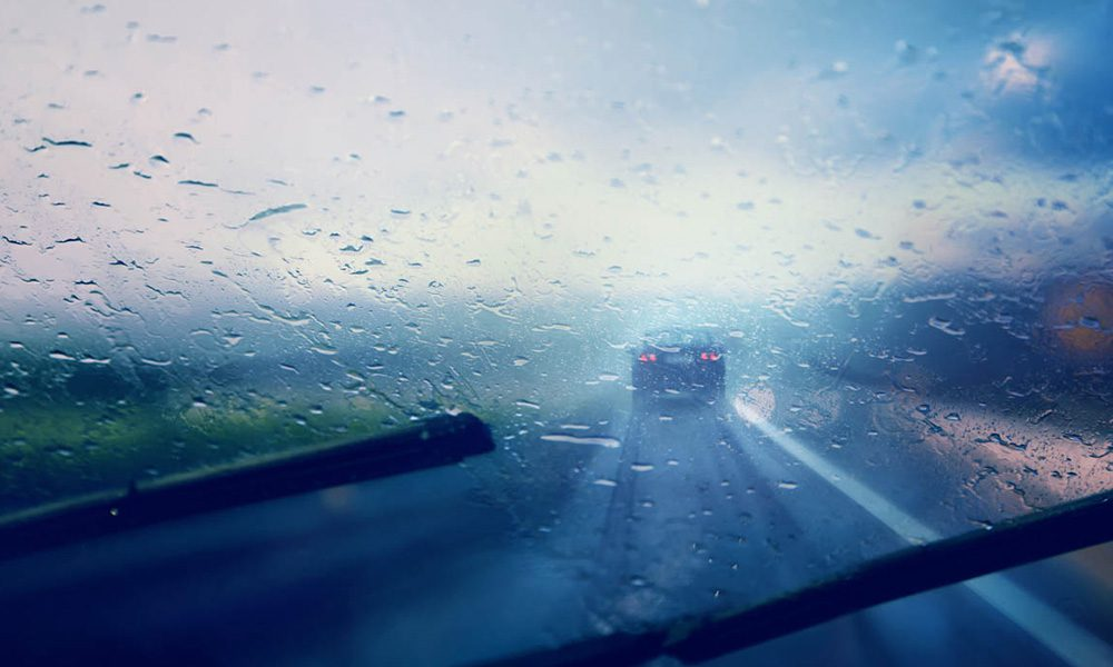 Blog - Hydroplaning 101 - Rainy Window Shield On A Car While Driving