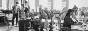 Employee Benefits - Successful Team Working and Collaborating In A Open Office Space
