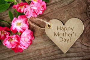 happy mothers day sign and flowers