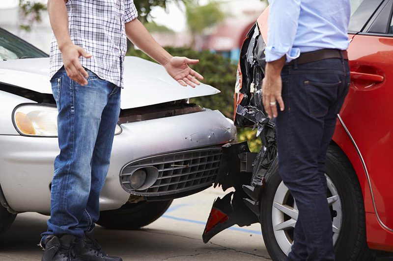 two people involved in a car crash talking