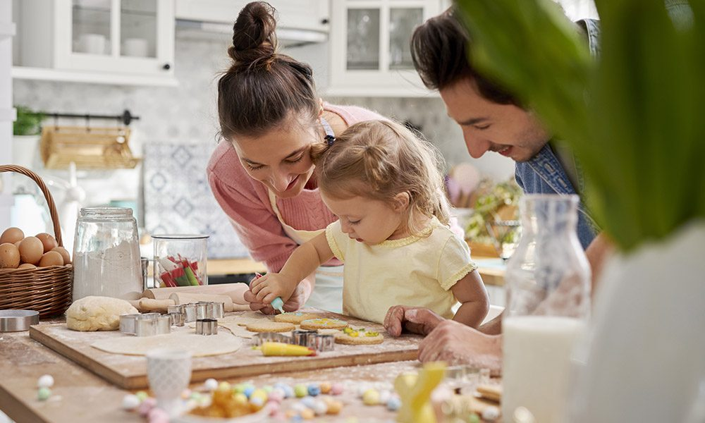 Blog - Family Making Cookies in Kitchen and Decorating for Easter