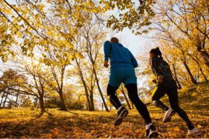Header - Employee Benefits People Running Through a Trail