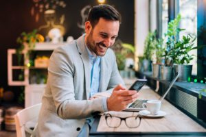 Blog-Business-Man-Using-His-Phone-To-Read-a-Blog
