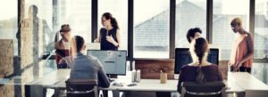 Header - About Employees around a Conference Table