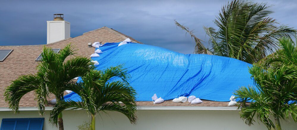 A Florida roof that's been damaged by a storm. Roof age can affect your insurance coverage