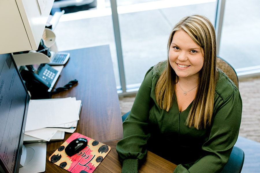 Team - Teagan Ottinger - Working At Her Desk In The Office