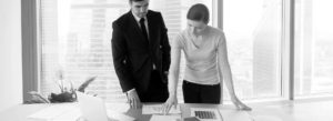 Header - Business Insurance Employees Looking at Documents Together