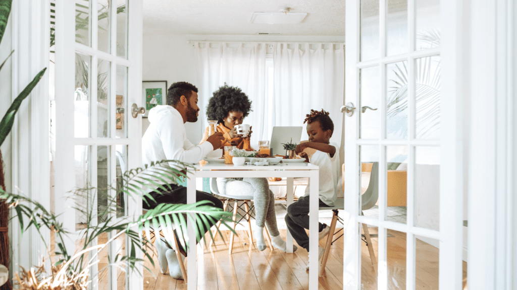family enjoying time together at the kitchen table in their home