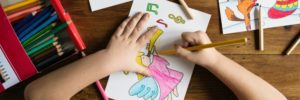 child coloring a picture