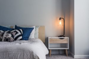 done bed with modern nightstand and lamp