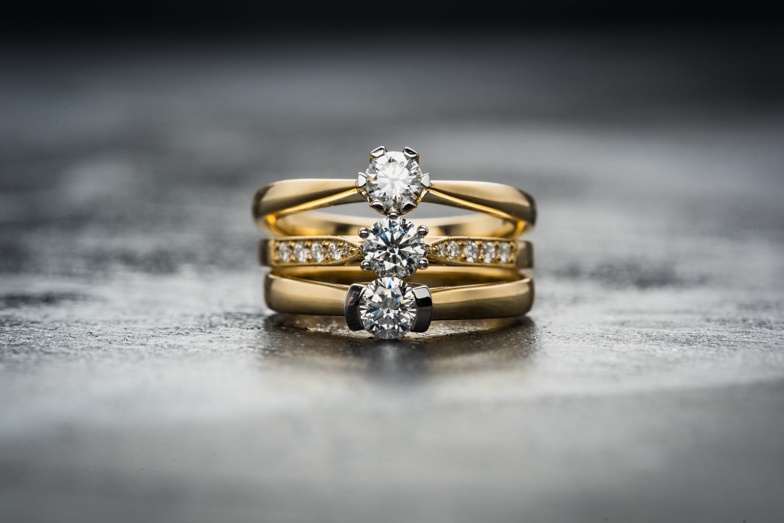 gold rings with diamonds stacked