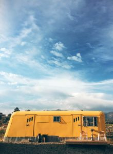 yellow rv bus in the middle of desert