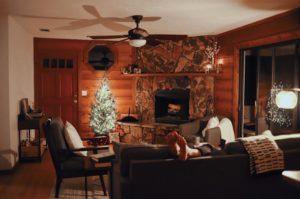 Log cabin with a fire place and Christmas tree