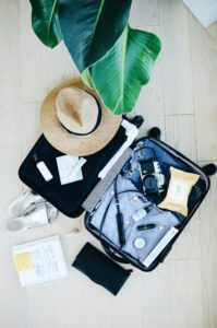 Suitcase being packed with vacation things