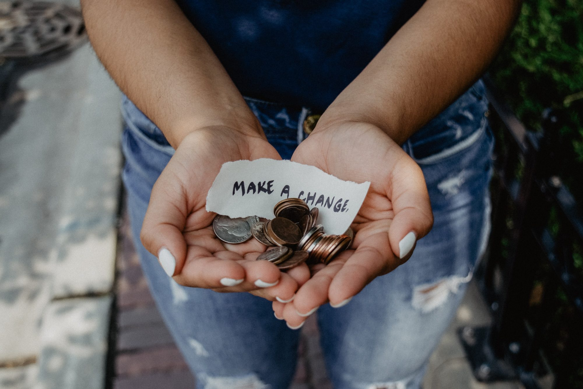 woman holding change in her hands
